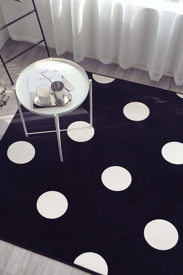 polka dot black rug with white. Side table and window