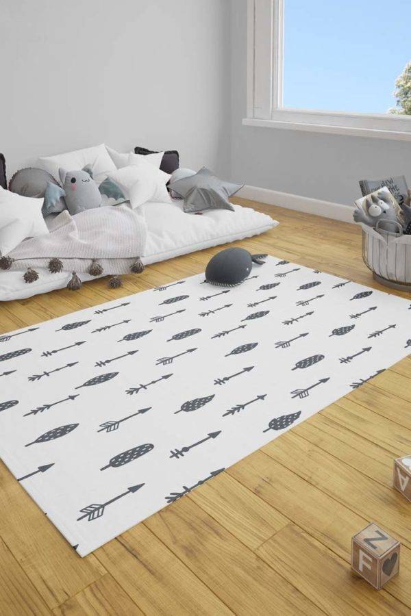 room with floorbards, window, couch, toys and black and white playmat