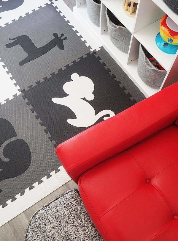 black and white playmat bookshelf and red chair