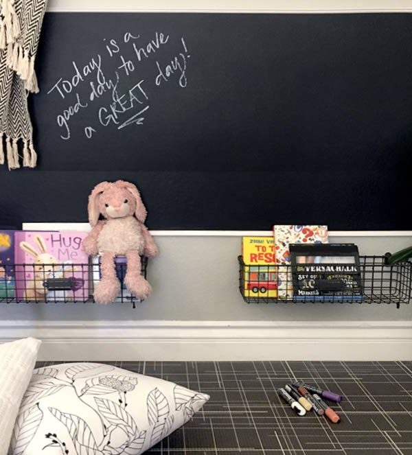 black and white modern playmat with blackboard and toys in play area