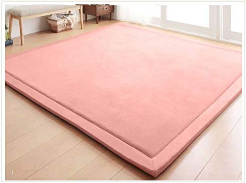 pink plush large square play mat on floor boards
