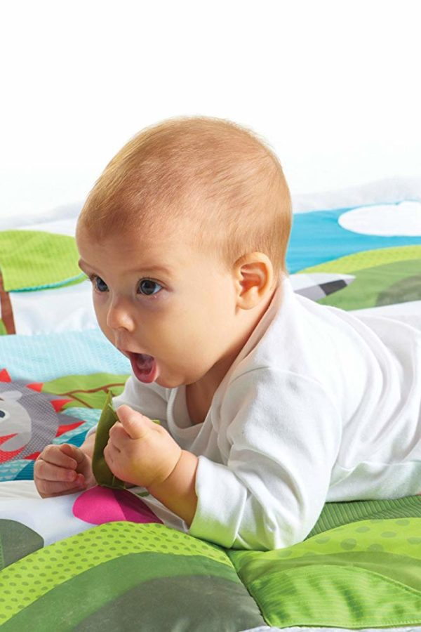 baby on playmat with teether