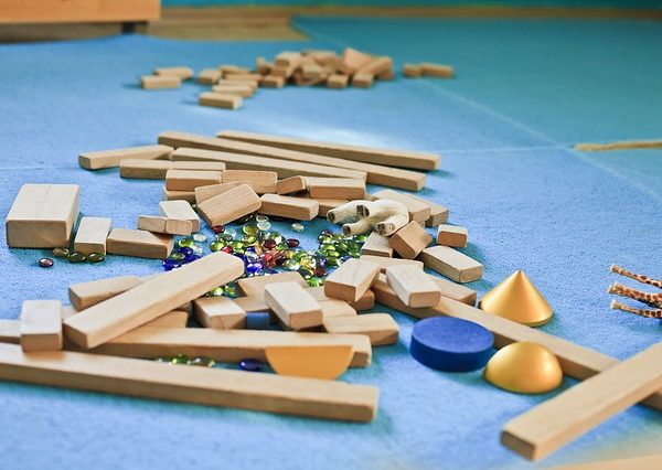 blue playmat with wooden blocks scattered
