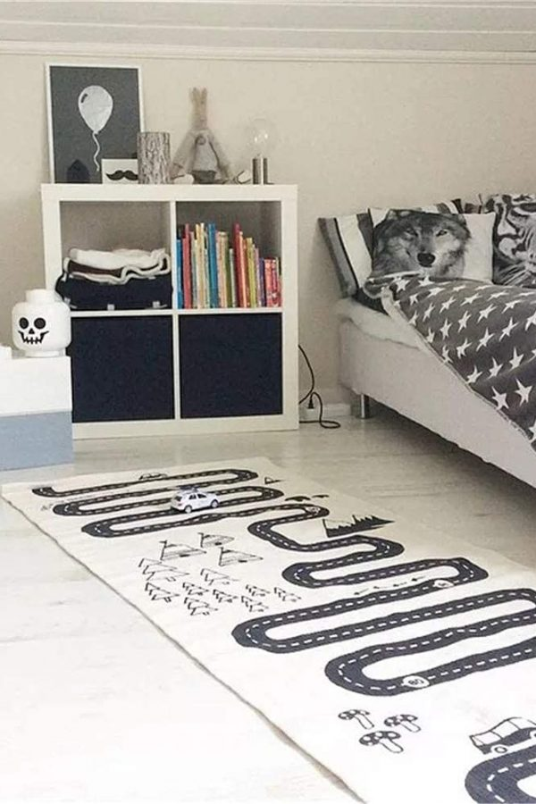 child's bedroom with black and white road playmat rug