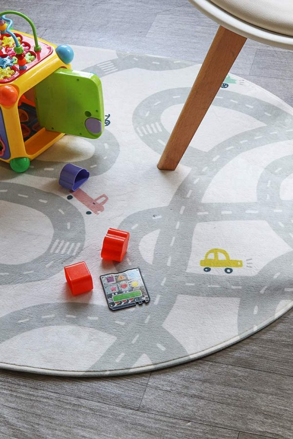 neutral road playmat wth toys and chair