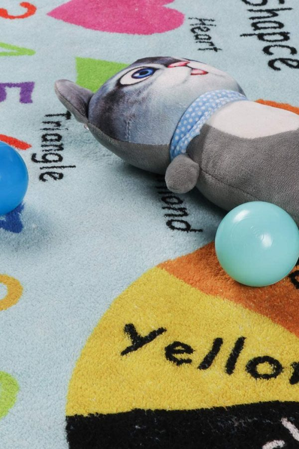 colored playmat with two balls and rabbit toy on top