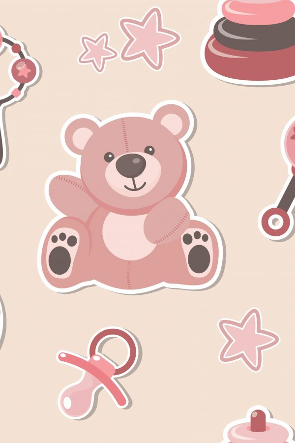 teddy bear, dummy and rattle on beige background